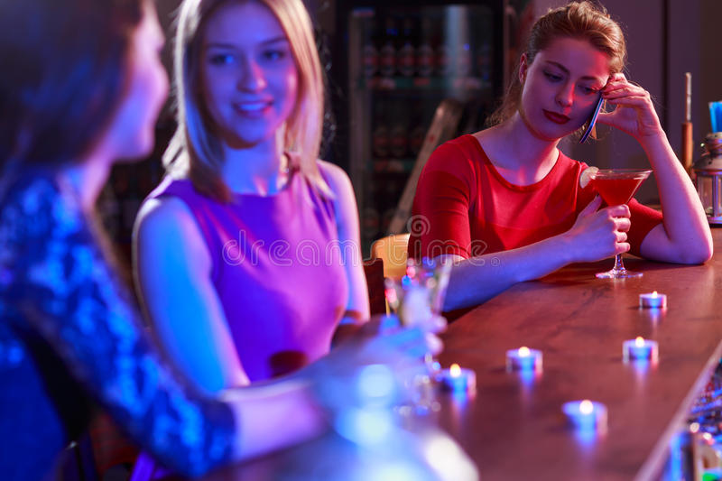 Waiting for friend. Waiting for late friend in night club stock images