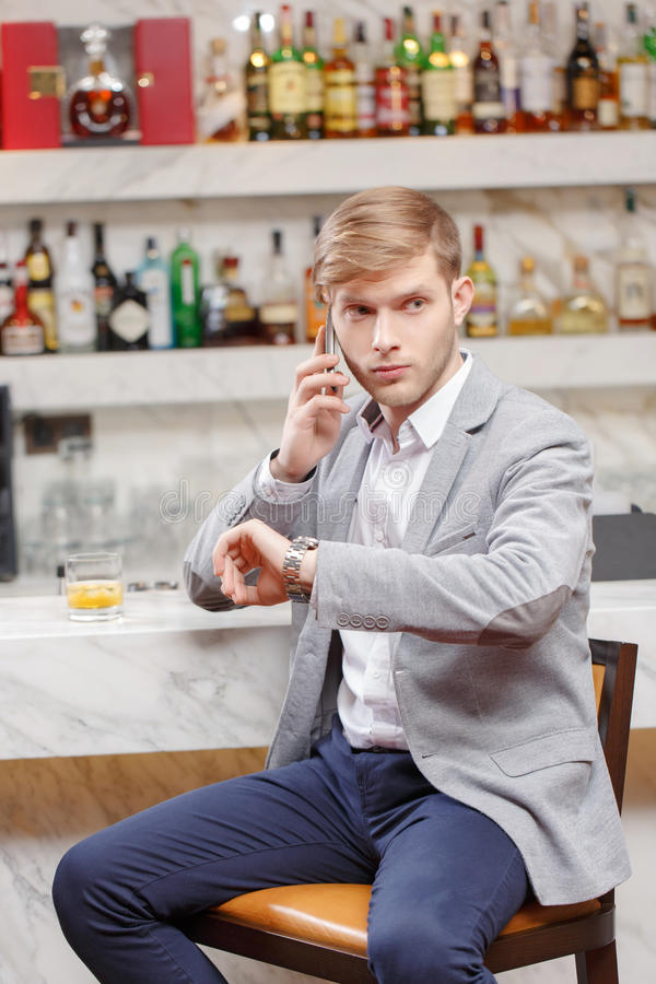 Waiting for friends in the bar stock photos