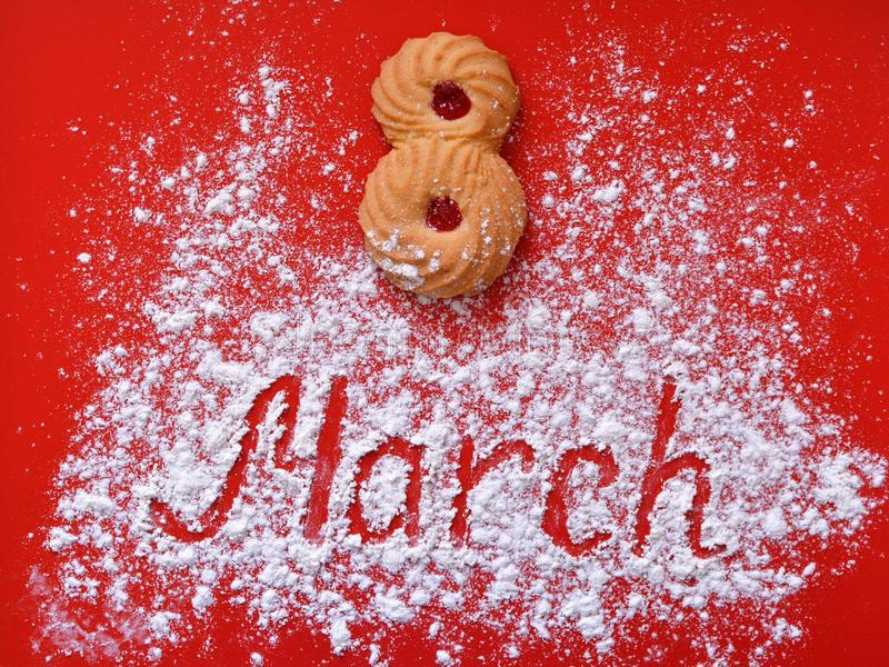 Waiting for the holiday. Cookies and inscription on a red background. stock photo