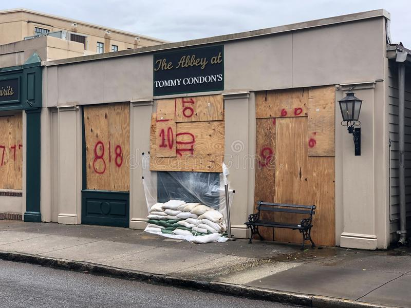 Waiting for Hurricane Dorian. Tommy Condon`s Restaurant and Pub on Church Street in Charleston, SC is boarded up and sandbagged to protect it from Hurricane royalty free stock photos