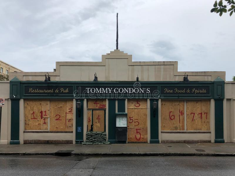Waiting for Hurricane Dorian. Tommy Condon`s Restaurant and Pub on Church Street in Charleston, SC is boarded up and sandbagged to protect it from Hurricane stock photos