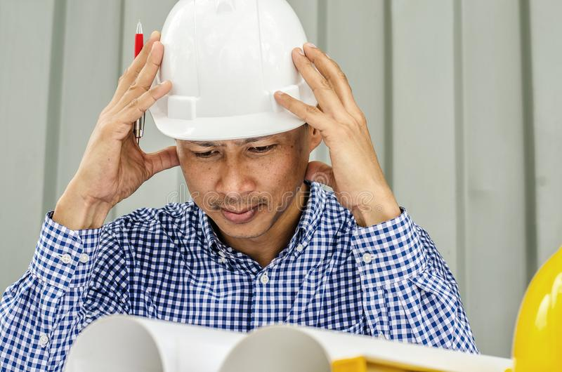 Waiting for inspiration. Asia Engineer serious thinking, royalty free stock image