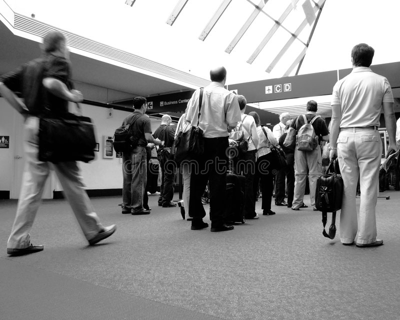 Waiting in line. At the airport with variety of people royalty free stock photography