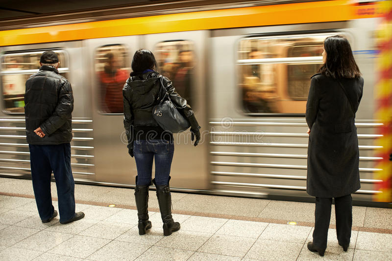 Waiting for the metro train. People waiting for the train in a metro station stock photos