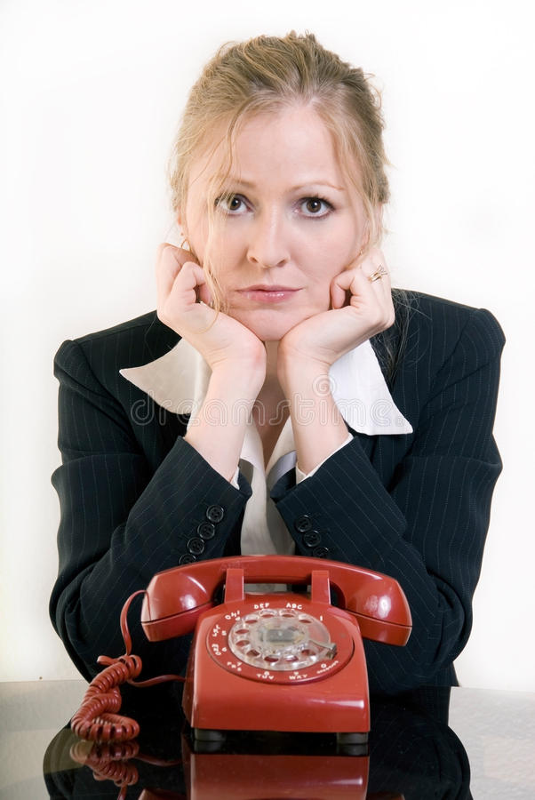 Waiting by the phone stock photography