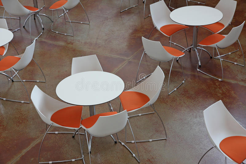 Waiting Room With Tables And Orange And White Chairs Stock