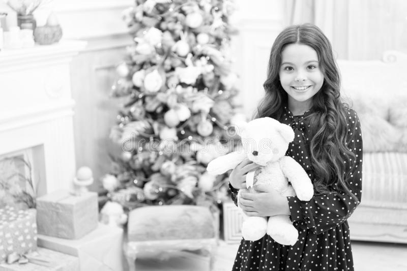 Waiting for santa. Winter. Cute little child girl with xmas present. happy new year. Christmas shopping. christmas. Family holiday. The morning before Xmas royalty free stock image