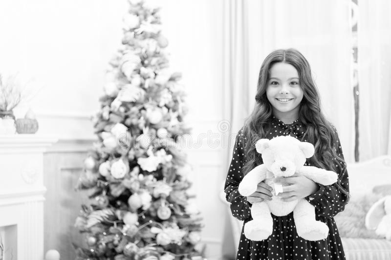 Waiting for santa. Xmas. Cute little child girl with xmas present. happy new year. Christmas shopping. christmas family. Holiday. The morning before Xmas. Beat stock photography