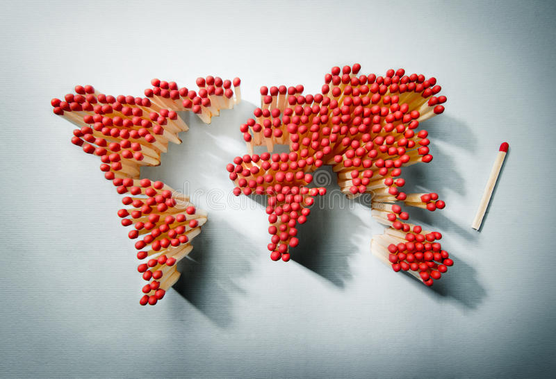 Waiting for the spark. World map made of matches waiting for a spark royalty free stock images