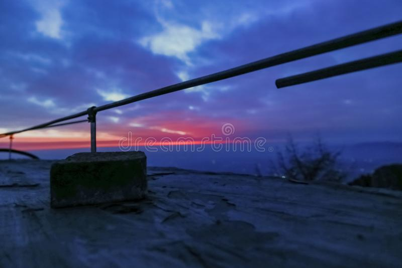 Waiting for sunrise atop mount tai.The observation deck has iron railings, and a piece of masonry. This is the scene taken at the top of mount tai.Mount tai is royalty free stock photography