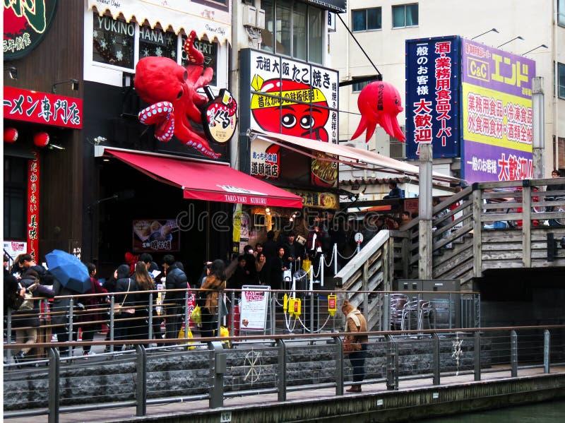 Waiting for takoyaki, Tazaemon Bridge, Dotonbori, Osaka, Japan stock photo