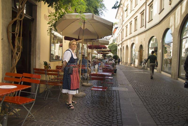 Waiting waitress, Bolzano Italy stock photo