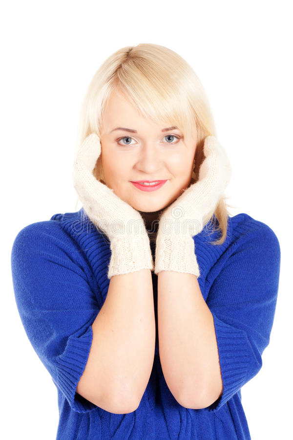 Waiting for the winter. Portrait of beautiful woman in blue sweater and white mitten on isolated white background stock photos