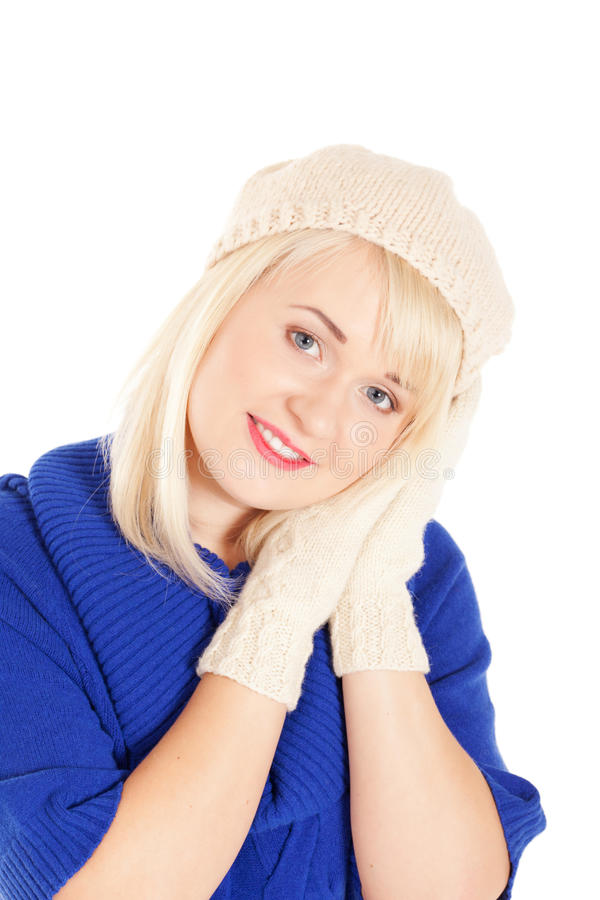 Waiting for the winter. Portrait of beautiful woman in blue sweater and white mitten and beret on isolated white background stock photos