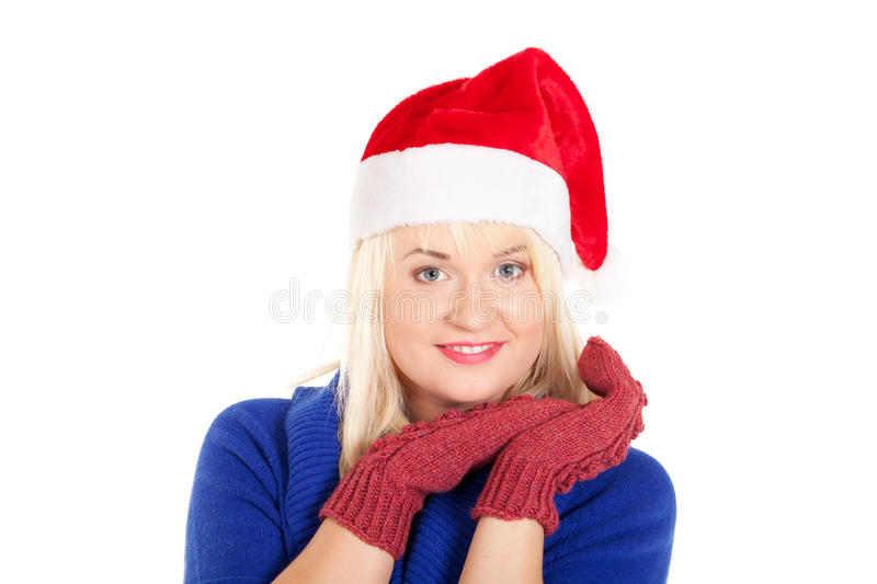 Waiting for the winter. Portrait of beautiful woman in blue sweater and red mitten and Santa's cap on isolated white background stock images