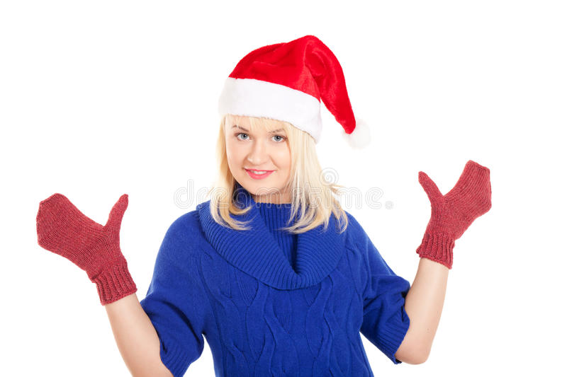 Waiting for the winter. Portrait of beautiful woman in blue sweater and red mitten and Santa's cap on isolated white background stock image