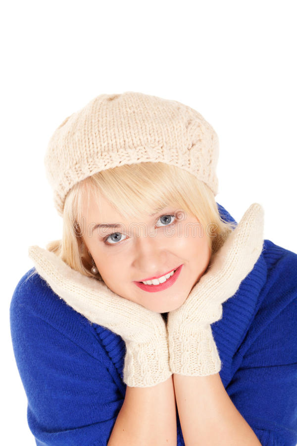 Waiting for the winter. Portrait of beautiful woman in blue sweater and white mitten and beret on isolated white background royalty free stock image