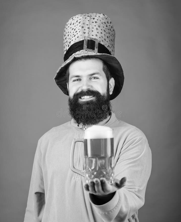 Waiting for you. Bearded man toasting to saint patricks day. Irish man with beard drinking green beer. Celebrating saint stock photography
