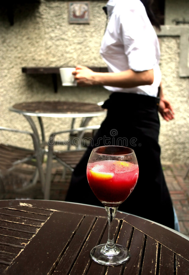 Waitress. Glides by a table
