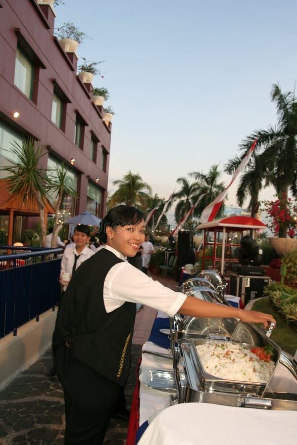 Waitress at banquet stock photography
