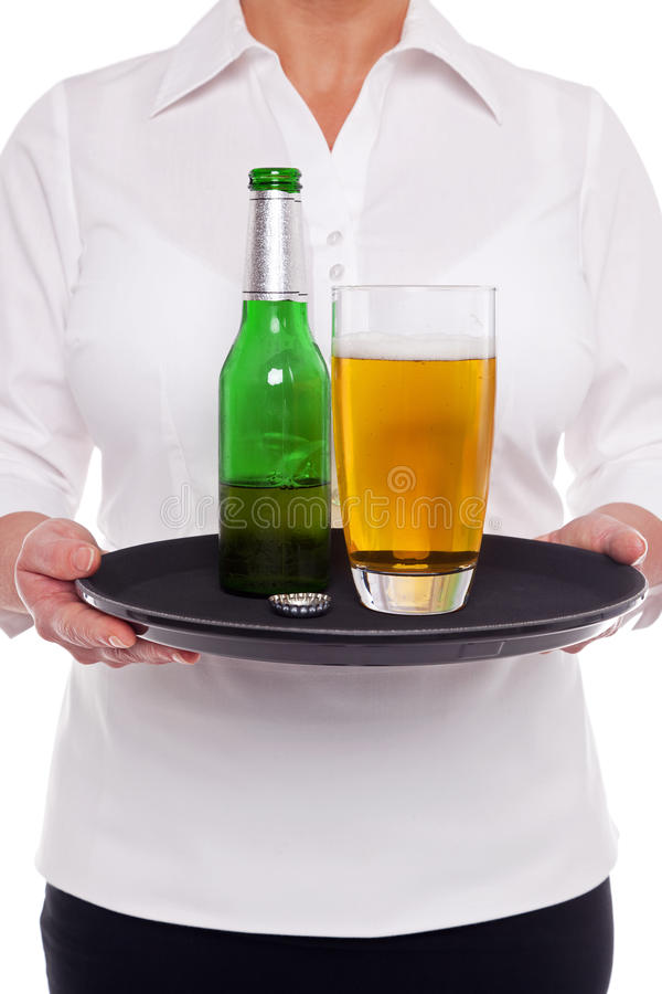 Waitress with beer on a tray stock images