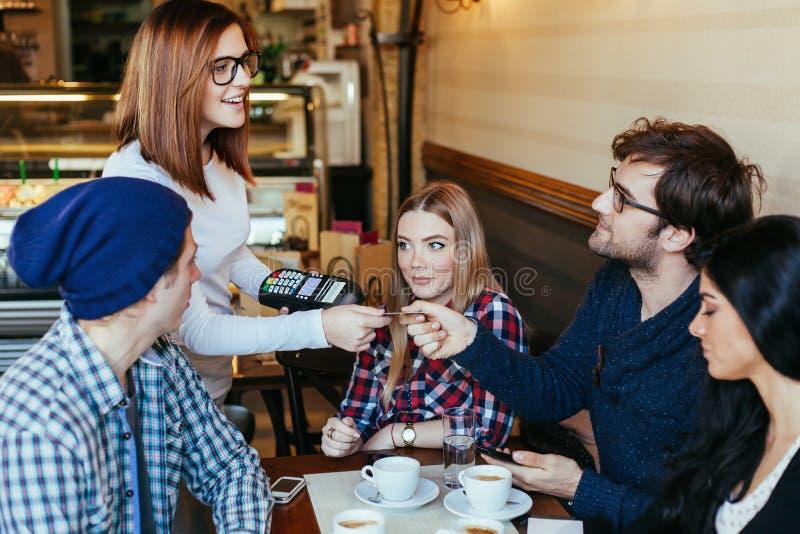 Waitress Charging Customers Bill stock images