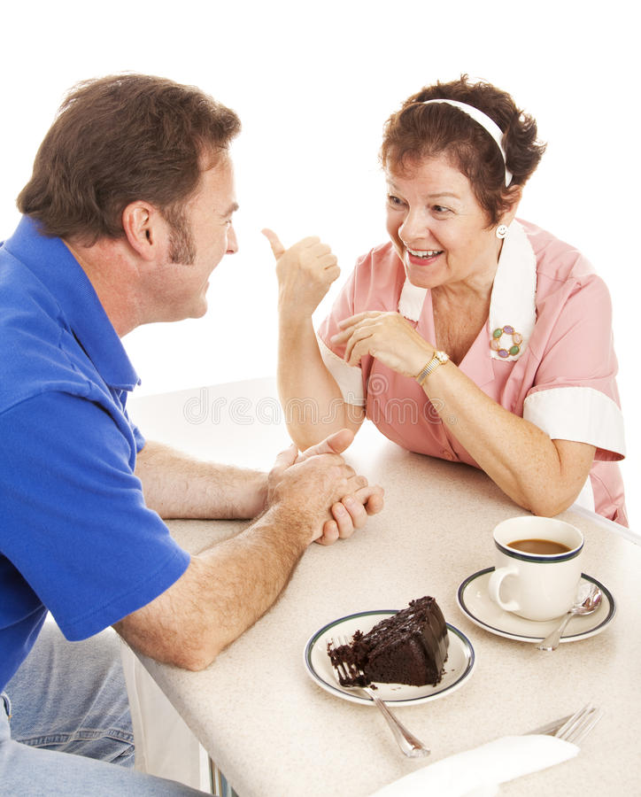 Waitress Chats with Customer royalty free stock image