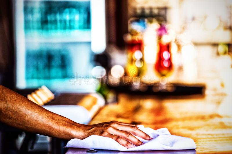 Waitress cleaning the counter in a restaurant. Close-up stock photos