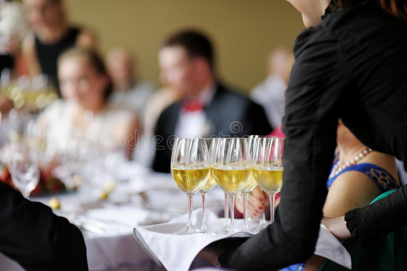 Download Waitress With Dish Of Champagne Glasses Stock Photo - Image: 27546108
