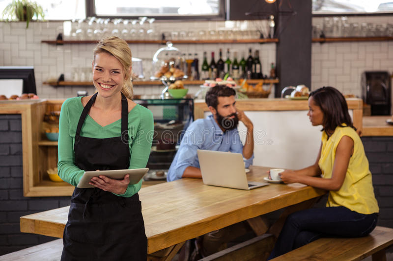 Waitress holding a tablet stock photos
