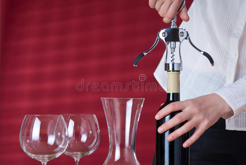 Waitress opening wine royalty free stock images