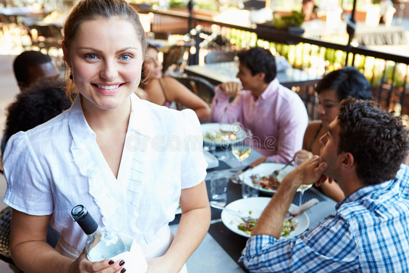 Waitress Serving Tables At Outdoor Restaurant stock photography