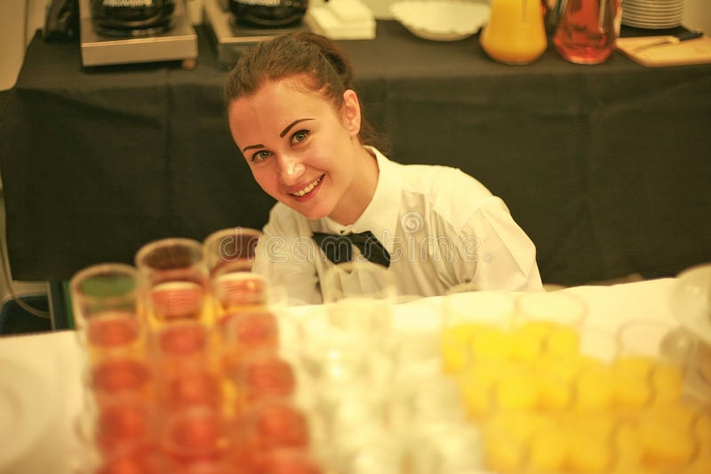 A waitress smiling stock photo