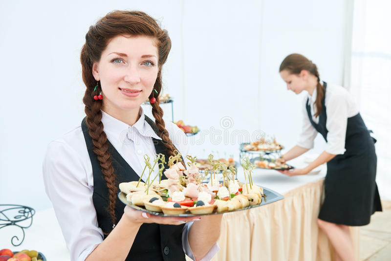 Waitress woman at restaurant catering event royalty free stock photo