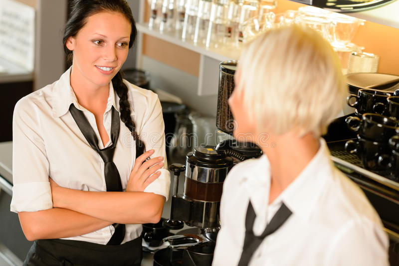 Waitresses talking gossiping in break cafe women royalty free stock photo