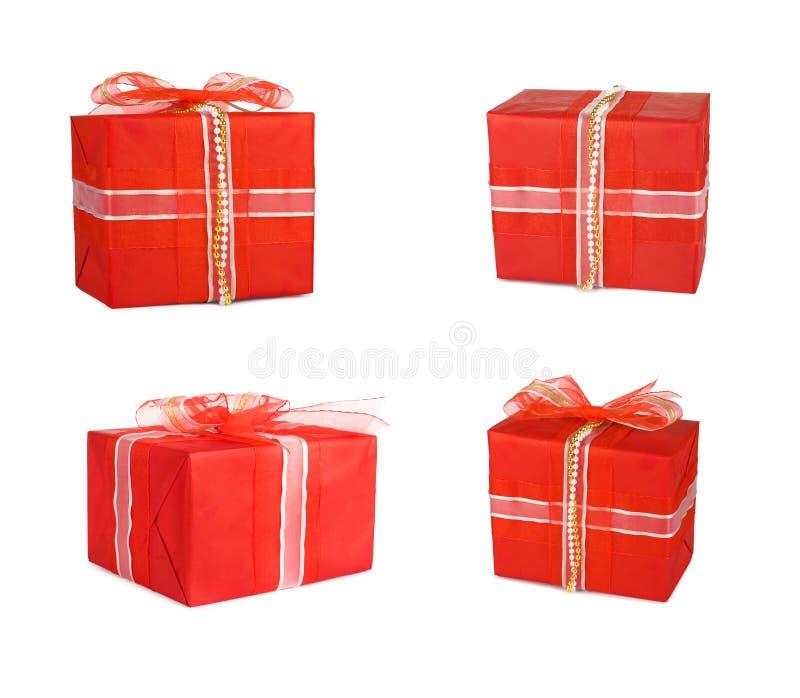 Wakacyjni ustaleni prezentów pudełka dekorowali z łękami i faborkami zdjęcia royalty free