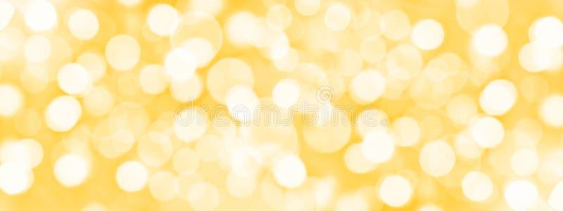 Wakacyjny złoty panoramiczny tło, zamazany bokeh zaświeca fotografia stock