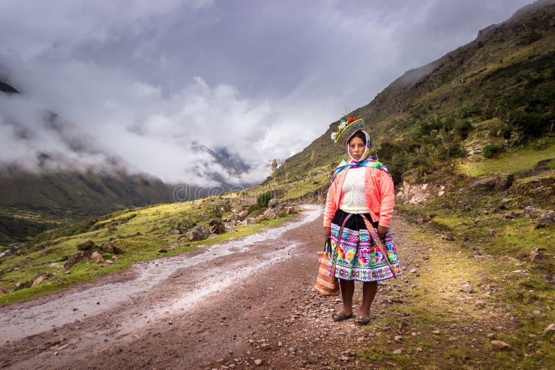 Wakawasi, Peru - Young Peruvian Woman Passer-by along the Inca Trail royalty free stock image