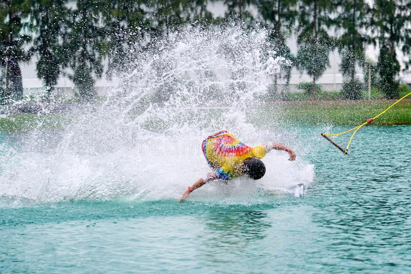 Wake boarding rider sliding and jumping trick with water splash. stock images