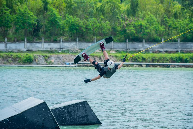 Wake boarding at the wake park. Outdoor and extreme sport stock photo