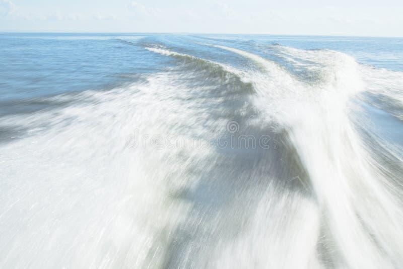 Speedboat wake on Lake Pontchartrain. The wake of a speedboat on Lake Pontchartrain, Madisonville, Louisiana royalty free stock image