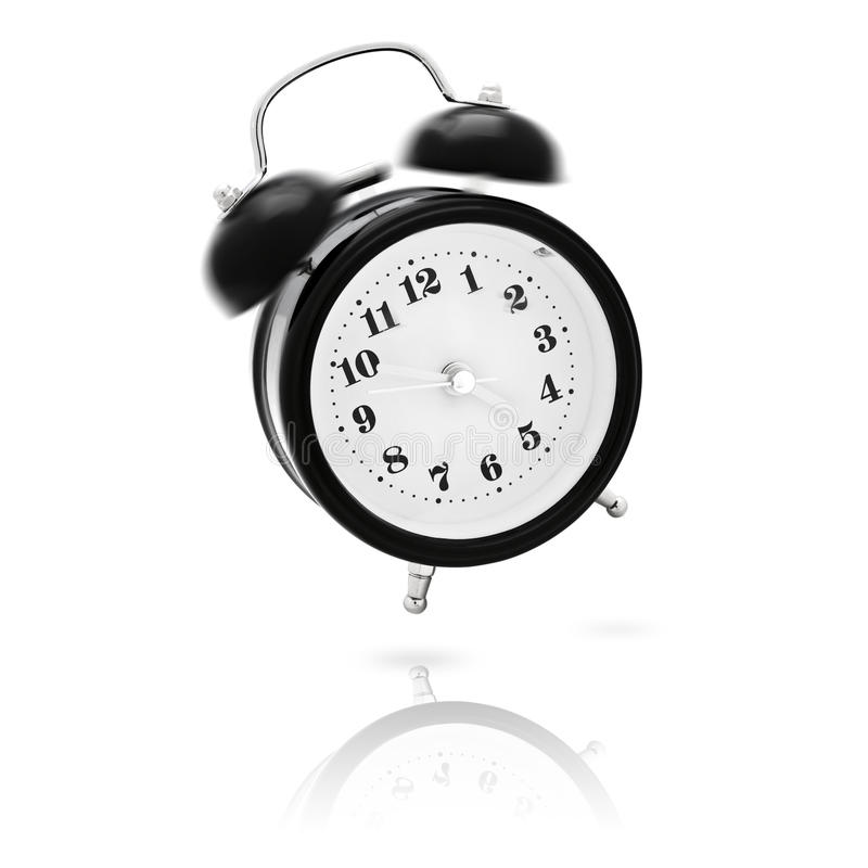 Wake up!. Vintage alarm clock ringing and jumping in the morning - it`s time to wake up stock image