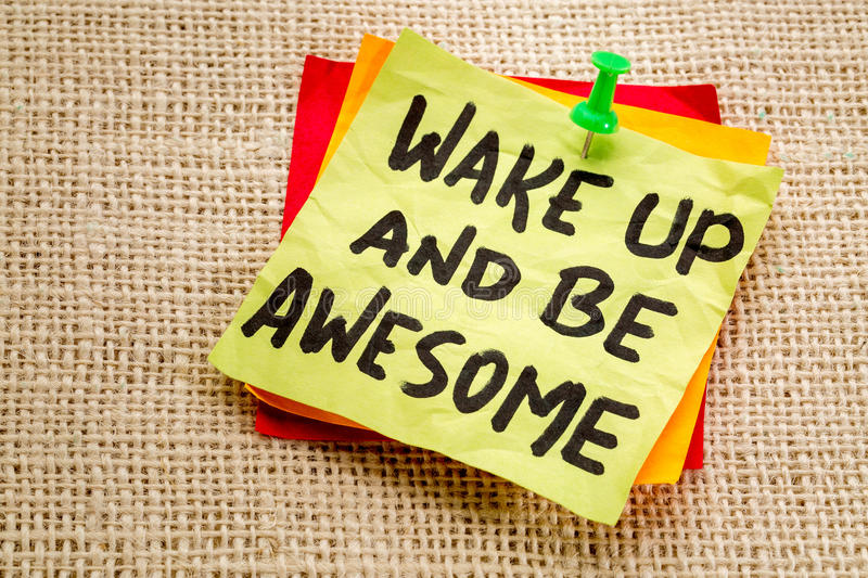 Wake up and be awesome note. Wake up and be awesome - motivational advice on a sticky note royalty free stock photography