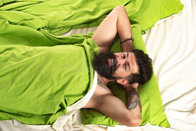 Wake up. Sleeping time. Man bearded hipster having problems with sleep. stock image
