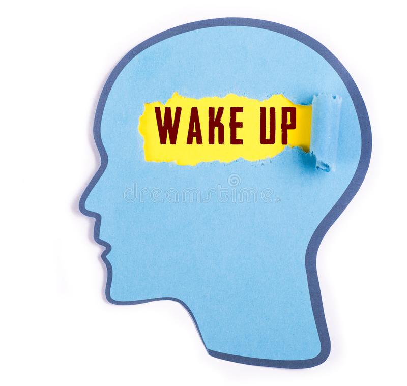 Wake up word in the person head. Torn blue paper and Paper head concept Thoughts inside the brain stock photography