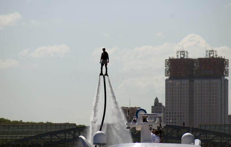 Wakeboarder performs at Navigation season-2018 opening in Gorky park, Moscow. royalty free stock images