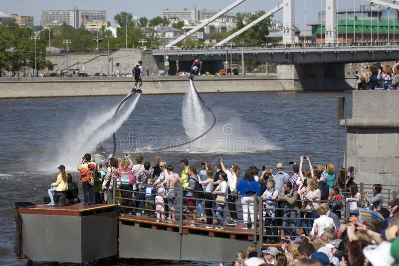 Wakeboarder performs at Navigation season-2018 opening in Gorky park, Moscow. royalty free stock photography