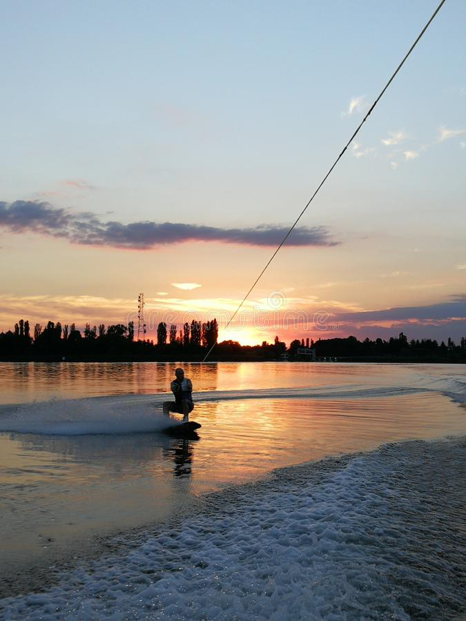 Wakeboarding at sunset royalty free stock photos
