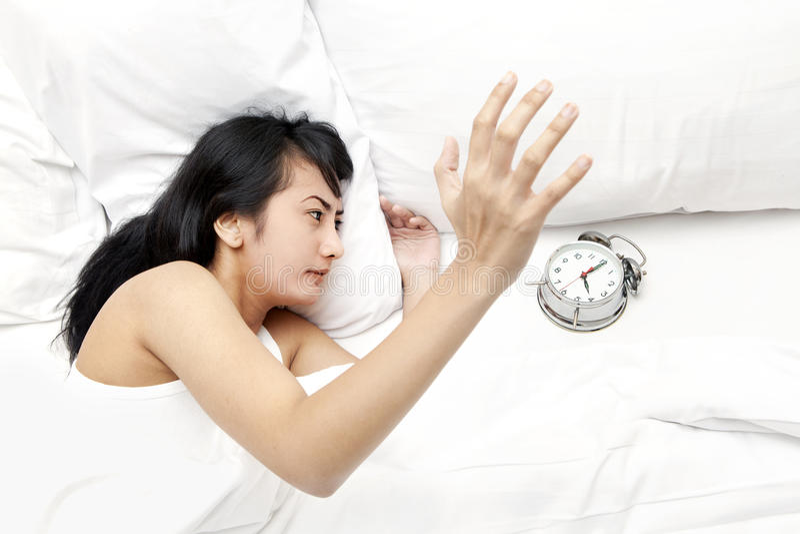 Waking Up By Alarm Clock Royalty Free Stock Photo