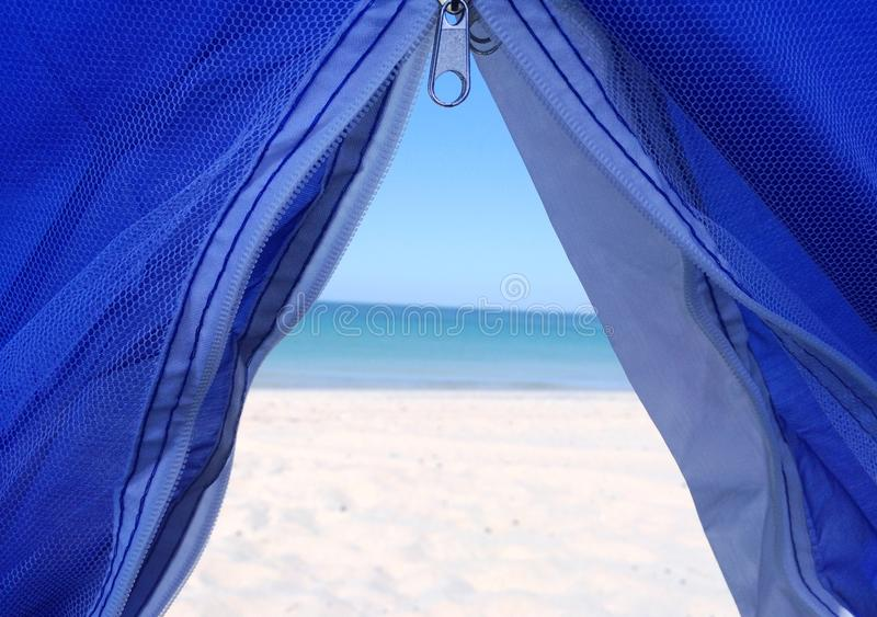 Oman, Musandam Beach, Blue Tent on Beach. Waking up in the morning on Musandam Beach having a fantastic view out of the blue tent onto the sea royalty free stock image